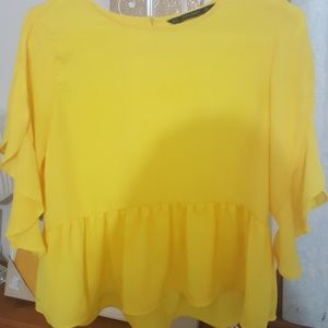 Yellow peplum blouse